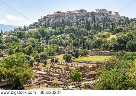 Ancient Agora In Athens, Greece. Scenic View Of Greek Ruins And Acropolis In Distance. Urban Landsca
