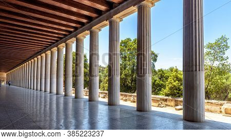 Perspective Of Classical Building Columns In Ancient Agora, Athens, Greece. Panoramic View Inside Th