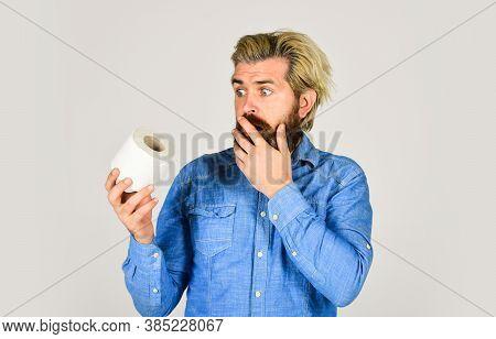 Bearded Man Hold Toilet Paper. Guy Suffer From Diarrhea. Toilet Paper Shortage In Coronavirus Panic.