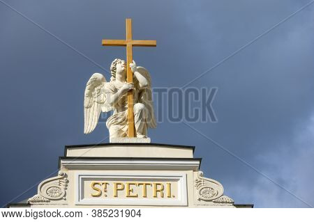 St. Petersburg, Russia - July 10, 2019: Statue of angel on the top of Lutheran Church of Saint Peter and Saint Paul. Built in 1838, it is one of the oldest and largest Protestant churches in Russia