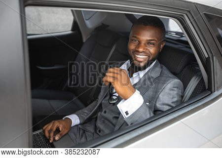 Rich African American Young Businessman Smiling Through Open Car Window. Cheerful Handsome Black Man