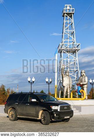 Novyy Urengoy, Russia - September 6, 2020: Black Offroad Car Toyota Sequoia At The Background Of The