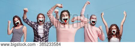 Group Of Winning, Happy People, Women And Men Wearing Protective Face Mask On Blue Background. Multi