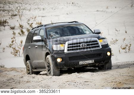 Novyy Urengoy, Russia - September 6, 2020: Black Offroad Vehicle Toyota Sequoia In The Sand Desert.
