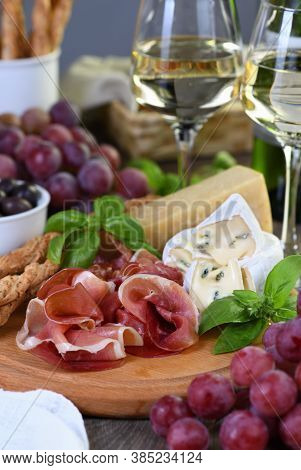 Antipasto. Wine Set Snacks Of Dried Ham, Camembert Cheese With Mold, Parmesan With Grissini, Olives