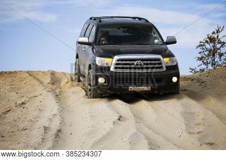 Novyy Urengoy, Russia - September 6, 2020: Luxury Offroad Car Toyota Sequoia In The Sand Desert.