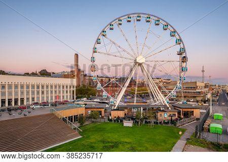 Helsinki, Finland - August 15, 2019: Observation wheel  at sunset in Helsinki, Finland.