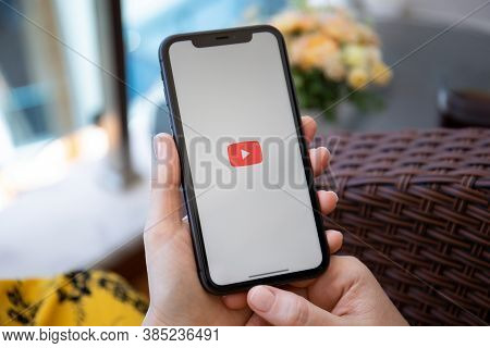 Alanya, Turkey - June 6, 2020: Woman Hand Holding Apple Iphone 11 With App Youtube Provides Streamin