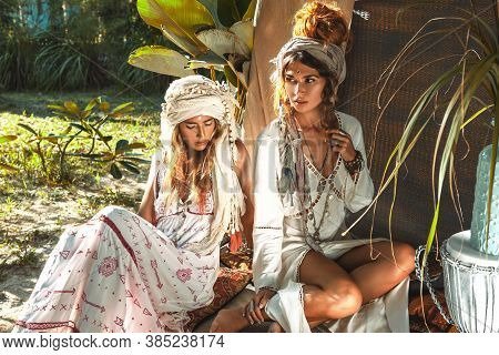 Two Beautiful Young Woman In Summer Dresses Outdoors At Sunset