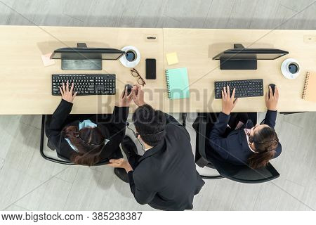 Business People Wearing Headset From Top View In Office Working With Computer To Support Remote Cust
