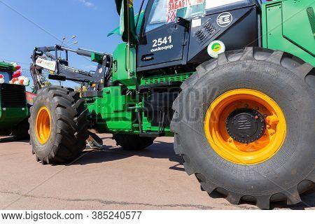 Minsk, Belarus - August 30 2020: Forwarder Crane When Clearing A Plantation. Wheeled Harvester. Harv
