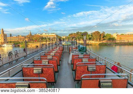 Seville, Andalusia, Spain - April 19, 2016: City Sightseeing Of Seville From Point Of View Of Hop-on