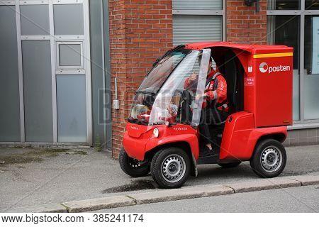 Haugesund, Norway - July 22, 2020: Mailman Works His Route In An Electric Zero Emission Paxster Vehi
