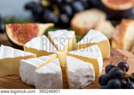 Camembert Cheese Or Brie Cheese Slices On Wooden Board, Closeup View. Gourmet French Cheese