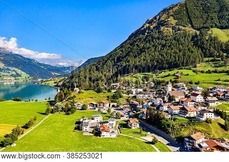 Graun Im Vinschgau, A Town On Lake Reschen In South Tyrol, Italian Alps