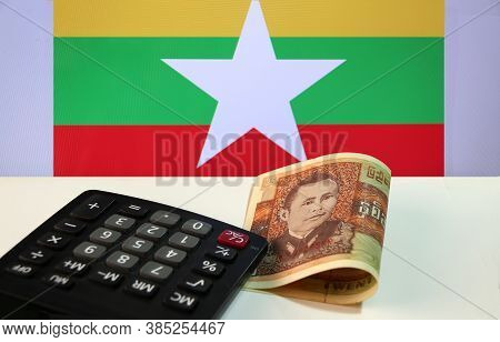Twenty-five Of Banknote Currency Myanmar Kyats With Calculator On The White Floor With The Union Of