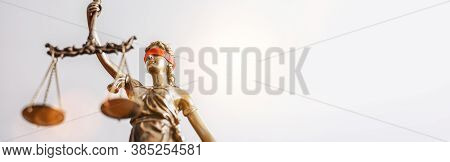 The Statue Of Justice - Lady Justice Or Iustitia / Justitia The Roman Goddess Of Justice With Red Bl