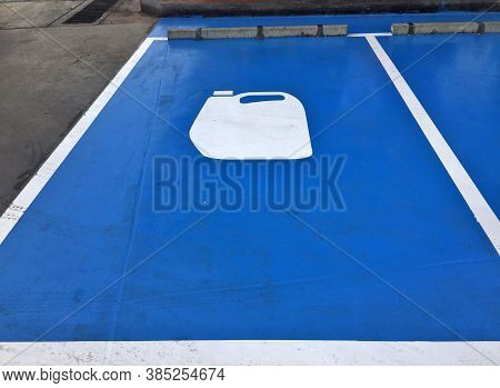 Blue Car Park And White Symbolic Of Gallon Of Lubricant On The Floor, Car Park In The Garage For Ser