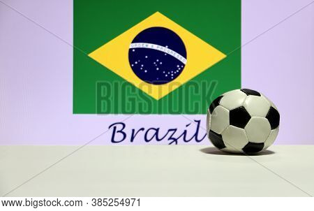 Small Football On The White Floor And Brazilian Nation Flag With The Text Of Brazil Background. The