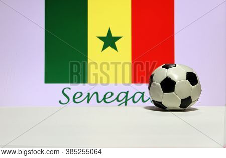 Small Football On The White Floor And Senegalese Nation Flag With The Text Of Senegal Background. Th