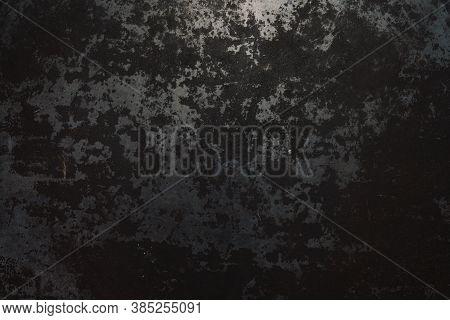 Rough, Dark Metal Background Lit By Spotlight Background