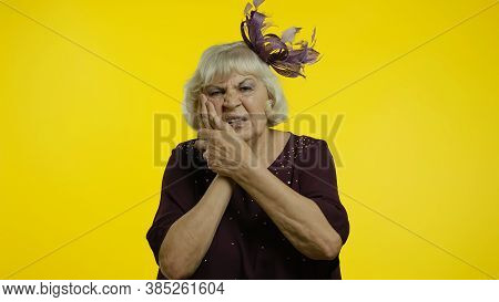 Dental Problems. Unhealthy Senior Old Woman Touching Sore Cheek, Suffering Terrible Toothache, Horri
