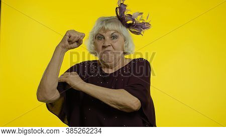 I Am Strong And Independent. Senior Old Woman Showing Biceps And Looking Confident, Feeling Power St