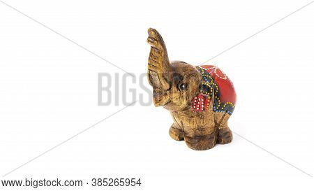 Figurine Of A Wooden Elephant With Pattern On The Back Isolated On White Background. Decorative Figu