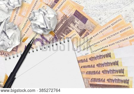 20 Belorussian Rubles Bills And Balls Of Crumpled Paper With Blank Notepad. Bad Ideas Or Less Of Ins