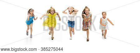 Happy Children, Little And Emotional Caucasian Kids Jumping And Running Isolated On White Background