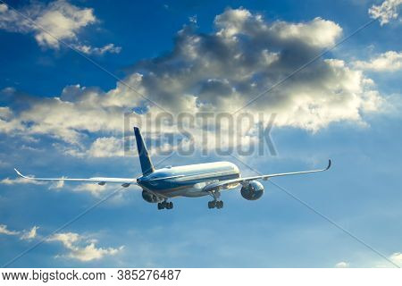 Big airplane fly to blue sky after taking off at sunset.Travel background. Passenger plane. Commercial aircraft. Private jet