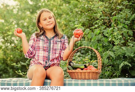 Girl Cute Smiling Child Living Healthy Life. Eat Healthy. Summer Harvest Concept. Organic Harvest. H