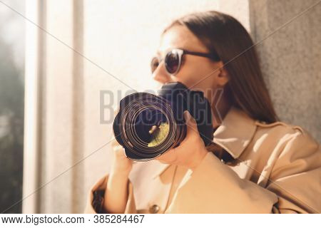 Private Detective With Camera Spying Near Building On City Street