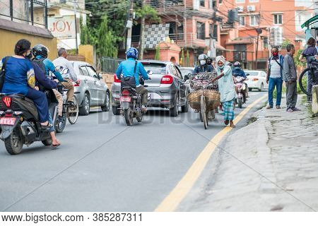 Kathmandu, Nepal - Sept 14, 2020: Street Life And Traffic Resume Despite A Lockdown In The Kathmandu
