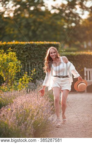 Beautiful Young Woman In The Sunset Light. Portrait Of A Beautiful Woman In Blooming Lavender. Summe