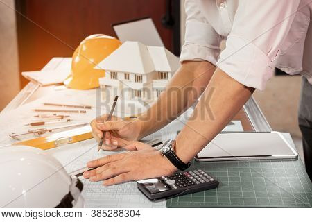 Engineer Or Architect Hand Sketch The Drawing Construction Building On The Desk. Civil Engineering,