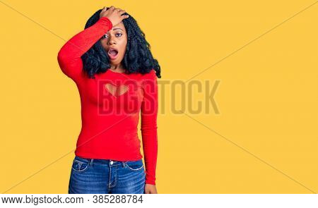 Beautiful african american woman wearing casual clothes surprised with hand on head for mistake, remember error. forgot, bad memory concept.