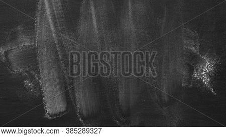 Empty Black Chalkboard. School Board Background With Traces Of Chalk. Chalkboard Texture.