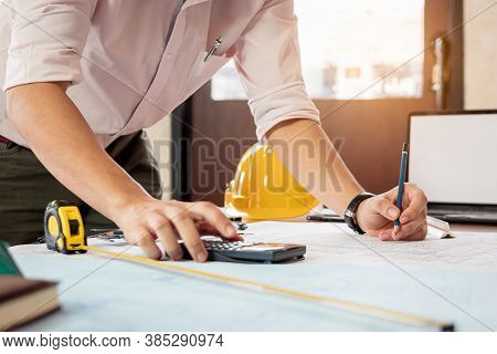 Engineer Or Architect Calculate And Sketch The Drawing Construction Building. Civil Engineering, Arc