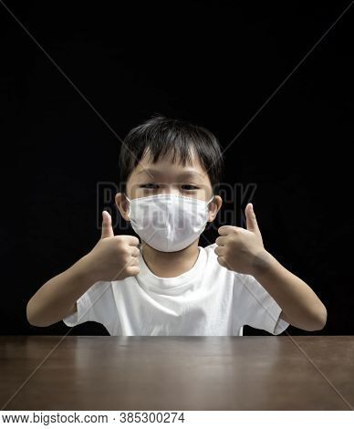 Very Happy Little Boy Wearing A Medical Face Mask Is Showing Thumbs Up , Coronavirus (covid-19) Prev