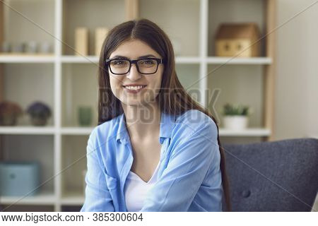 Smiling Woman Looking At Camera During Work Teleconference Or Videocall