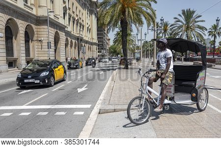 Barcelona, Catalonia, Spain; June 10, 2017: Tourist Tricycle In The City Center And Typical Taxi In