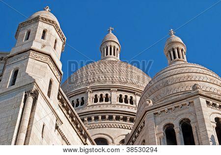 Sacre Coeur Basilica against a blue sky