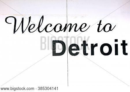Detroit, MI USA - 8/30/2020:  Welcome to Detroit text on white sheet metal board at downtown Detroit