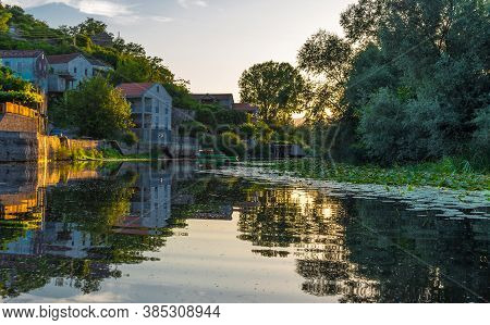Reflection In Crnojevica River During Sunset. The River Flows Into Lake Skadar. Montenegro.
