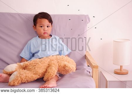 Cute Asian Child About 2 Years Old On The Sofa In The Living Room And Lots Of Mosquitoes Are Biting
