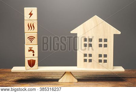 House And Blocks With Utilities Public Service Symbols On Scales. Availability Of Bill Payment. Home