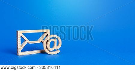 Email Figure On Blue Background. Envelope And At Commercial Sign Symbol. Concept Of Email Address. C