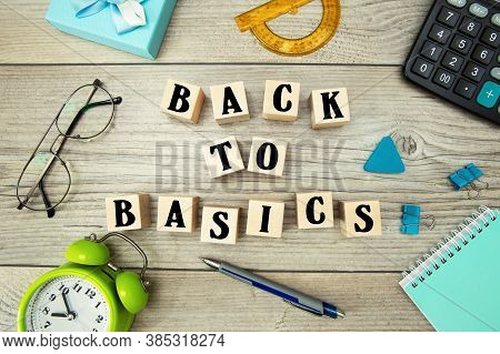 The Inscription On The Cubes Back To Basics. Back To Basics Text On A Table