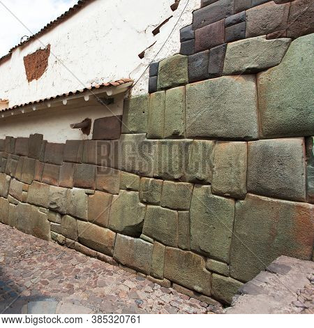 Beautiful Narrow Street And Buildings Wall In Centre Of Cusco Or Cuzco City, Peru